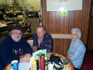 John Williams with Doug & Judy Wise owners of Sykes\'